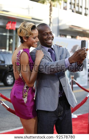 LOS ANGELES - JUN 27: Selita Ebanks; Malcolm Barrett at the Premiere of Universal Pictures' 'Larry Crowne' at Grauman's Chinese Theatre on June 27, 2011 in Los Angeles, California - stock photo