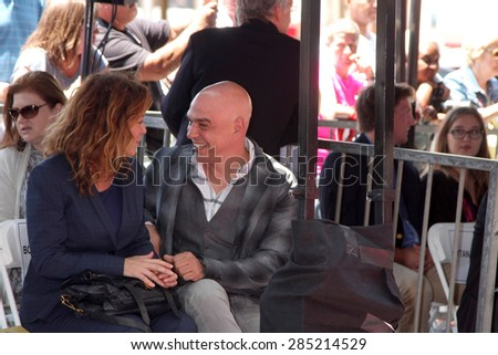 LOS ANGELES - JUN 2:  Susie Fogelson, Michael Symon at the Bobby Flay Hollywood Walk of Fame Ceremony at the Hollywood Blvd on June 2, 2015 in Los Angeles, CA - stock photo