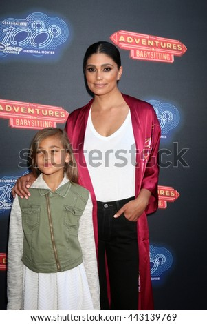 LOS ANGELES - JUN 23:  Tallulah Ruth Dash, Rachel Roy at the 100th DCOM Adventures In Babysitting LA Premiere Screening at the Directors Guild of America on June 23, 2016 in Los Angeles, CA - stock photo