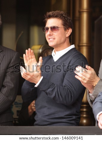 LOS ANGELES - JUN 23:  Tom Cruise arrives to the Walk of Fame Honors Jerry Bruckheimer  on June 23, 2013 in Hollywood, CA                 - stock photo
