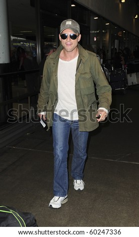 LOS ANGELES-JUNE 17: Actor Christian Slater is seen at LAX. June 17, 2010 in Los Angeles, California