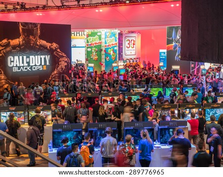 LOS ANGELES - June 16, 2015: Crowds of people at E3 2015 expo in Convention Center. Electronic Entertainment Expo, commonly known as E3, is an annual trade fair for the computer video game industry. - stock photo