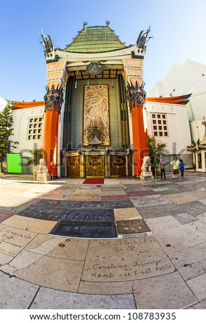 LOS ANGELES - JUNE 26: Grauman's Chinese Theatre on June 26, 2012 in Los Angeles, CA. There are nearly 200 Hollywood celebrity handprints, footprints and autographs in the concrete of its forecourt. - stock photo