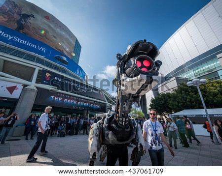 LOS ANGELES - June 14, 2016: Horizon Zero Dawn game machine monster character greeting gaming industry people crowd in front of E3 2016 Electronic Entertainment Expo entrance.  - stock photo