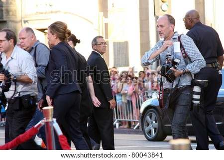 "LOS ANGELES - JUNE 27:  Julia Roberts, press, security arriving at the ""Larry Crowne"" World Premiere at Chinese Theater on June 27, 2011 in Los Angeles, CA - stock photo"