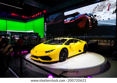 LOS ANGELES - JUNE 12: Microsoft introducing Forca Horizon 2 for Xbox One and 360 with a Lamborghini Huracan at E3 2014, the Expo for video games on June 12, 2014 in Los Angeles - stock photo