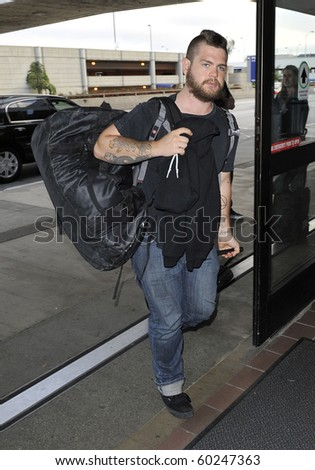 LOS ANGELES-JUNE 24: Ozzy and Sharon Osbourne son Jack Osbourne is seen at LAX. June 24, 2010 in Los Angeles, California