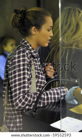 LOS ANGELES-JUNE 14: Popstar Miley Cyrus is seen at LAX. June 14, 2010 in Los Angeles, California - stock photo