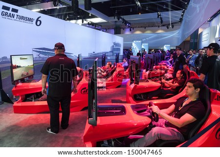 LOS ANGELES - JUNE 11: Sony unveiling Gran Turismo 6 for PlayStation 4 for the first time at E3 2013, the Expo for video games on June 11, 2013 in Los Angeles - stock photo
