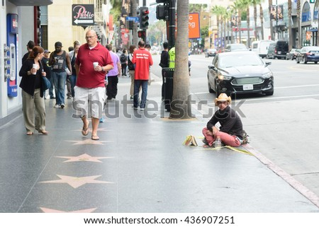 LOS ANGELES - JUNE 11, 2016: Street artists around the world famous Walk Of Fame on Hollywood Boulevard in Los Angeles, USA.  - stock photo