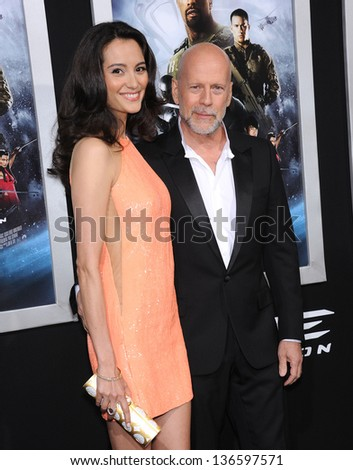 """LOS ANGELES - MAR 28:  Bruce Willis & Emma Heming arrives to the """"G.I. Joe: Retaliation"""" Los Angeles Premiere  on March 28, 2013 in Hollywood, CA. - stock photo"""