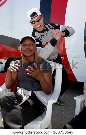 LOS ANGELES - MAR 15:  Colin Egglesfield, Carmelita Jeter at the Toyota Grand Prix of Long Beach Pro-Celebrity Race Training at Willow Springs International Speedway on March 15, 2014 in Rosamond, CA - stock photo
