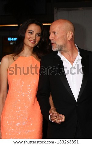 """LOS ANGELES - MAR 28:  Emma Heming, Bruce Willis arrives at the """"G.I. Joe: Retaliation""""  LA Premiere at the Chinese Theater on March 28, 2013 in Los Angeles, CA - stock photo"""