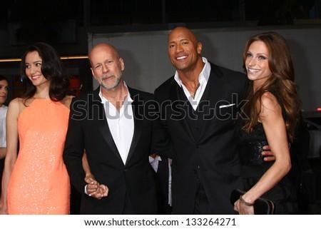 "LOS ANGELES - MAR 28:  Emma Heming, Bruce Willis, Dwayne Johnson, Lauren Hashian arrives at the ""G.I. Joe: Retaliation""  LA Premiere at the Chinese Theater on March 28, 2013 in Los Angeles, CA - stock photo"
