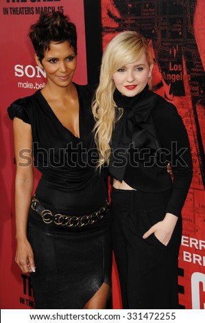LOS ANGELES - MAR 5 - Halle Berry and Abigail Breslin  arrives at The Call World Premiere on March 5, 2013 in Los Angeles, CA              - stock photo