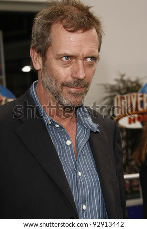 LOS ANGELES - MAR 27:  Hugh Laurie arriving at the World Premiere of 'HOP' held at Universal Studios Hollywood in Los Angeles, California on March 27, 2011. - stock photo