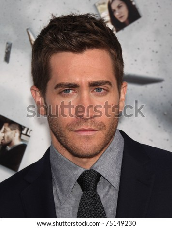 "LOS ANGELES - MAR 28:  Jake Gyllenhaal arrives to the ""Source Code"" Los Angeles Premiere  on March 28,2011 in Beverly Hills, CA - stock photo"