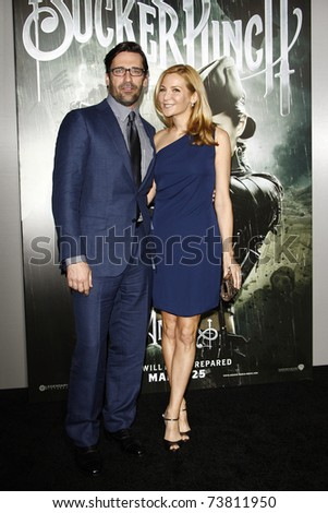 LOS ANGELES - MAR 23:  Jon Hamm, Jennifer Westfeldt arriving at the World Premiere of Sucker Punch at the Grauman's Chinese Theater in Los Angeles, California on March 23, 2011. - stock photo