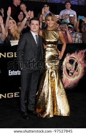 """LOS ANGELES - MAR 12:  Josh Hutcherson; Jennifer Lawrence arrives at the """"Hunger Games"""" Premiere at the Nokia Theater at LA Live on March 12, 2012 in Los Angeles, CA - stock photo"""