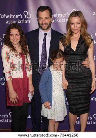"LOS ANGELES - MAR 16: Judd Apatow, Leslie Mann & kids arrive at the 19th Annual ""A Night at Sardi's"" Fundraiser & Awards on March 16, 2011 in Beverly Hills, CA - stock photo"