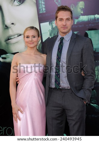 "LOS ANGELES - MAR 12:  Kristen Bell & Ryan Hansen arrives to the """"Veronica Mars"" Los Angeles Premiere  on March 12, 2014 in Hollywood, CA                 - stock photo"