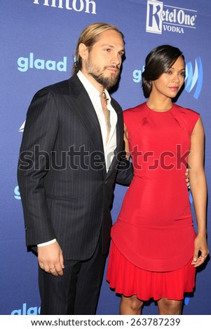 LOS ANGELES - MAR 21:  Marco Perego, Zoe Saldana at the 26th Annual GLAAD Media Awards at the Beverly Hilton Hotel on March 21, 2015 in Beverly Hills, CA - stock photo