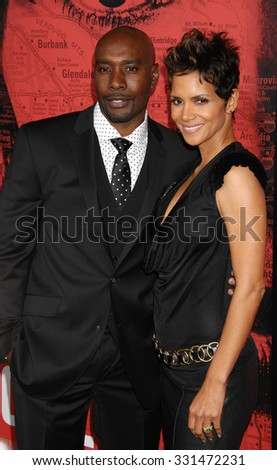 LOS ANGELES - MAR 5 - Morris Chestnut and Halle Berry arrives at The Call World Premiere on March 5, 2013 in Los Angeles, CA              - stock photo