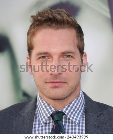 "LOS ANGELES - MAR 12:  Ryan Hansen arrives to the """"Veronica Mars"" Los Angeles Premiere  on March 12, 2014 in Hollywood, CA                 - stock photo"