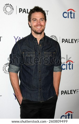 "LOS ANGELES - MAR 14:  Stephen Amell at the PaleyFEST LA 2015 - ""Arrow"" and ""The Flash"" at the Dolby Theater on March 14, 2015 in Los Angeles, CA - stock photo"