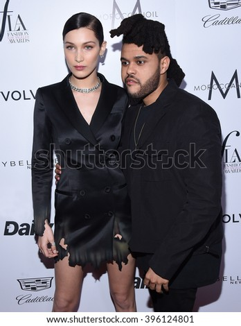 LOS ANGELES - MAR 20:  The Weeknd & Bella Hadid arrives to the 2nd Annual Fashion Los Angeles Awards  on March 20, 2016 in Hollywood, CA.                 - stock photo