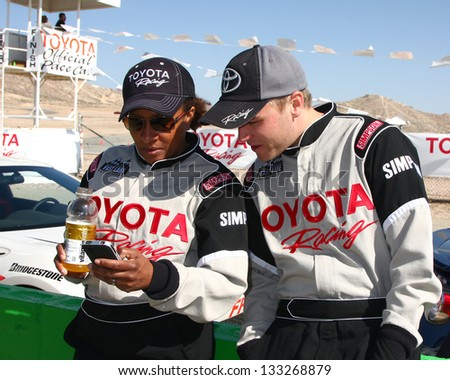 LOS ANGELES - MAR 23:  Wanda Sykes, Brett Davern at the 37th Annual Toyota Pro/Celebrity Race training at the Willow Springs International Speedway on March 23, 2013 in Rosamond, CA