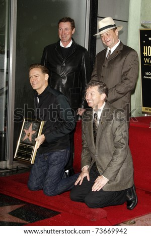 LOS ANGELES - MAR 21:  Wayne Gretzky, Sam Smith, Bryan Adams, Leron Gubler Bryan Adams is honored with a star on the Hollywood Walk of Fame on March 21, 2011 in Los Angeles, CA - stock photo