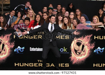 """LOS ANGELES - MAR 12:  Wes Bentley arrives at the """"Hunger Games"""" Premiere at the Nokia Theater at LA Live on March 12, 2012 in Los Angeles, CA - stock photo"""