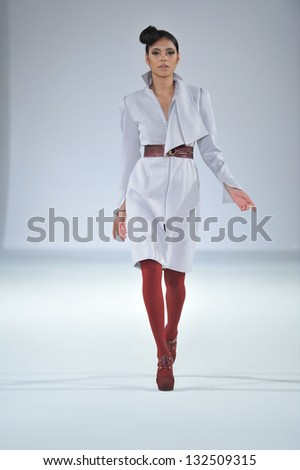 Los Angeles - March 11: A model walks the runway at the Gregorio Sanchez Fall 2013 fashion show during STYLE Fashion Week at Vibiana Cathedral on March 11, 2013 in Los Angeles, CA. - stock photo