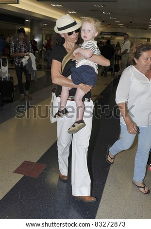 LOS ANGELES-MARCH 14: Actress Minnie Driver with son at LAX airport. March 14 in Los Angeles, California 2011 - stock photo