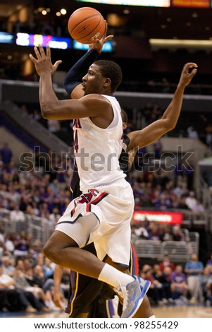 LOS ANGELES - MARCH 12: Arizona Wildcats F Solomon Hill #44 in action during the NCAA Pac-10 Tournament basketball championship game on March 12 2011 at Staples Center in Los Angeles, CA. - stock photo