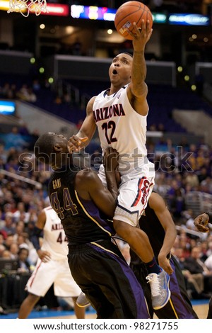 LOS ANGELES - MARCH 12: Arizona Wildcats G Lamont Jones #12 & Washington Huskies forward Darnell Gant #44 during the NCAA Pac-10 Tournament championship game on March 12 2011 at Staples Center. - stock photo