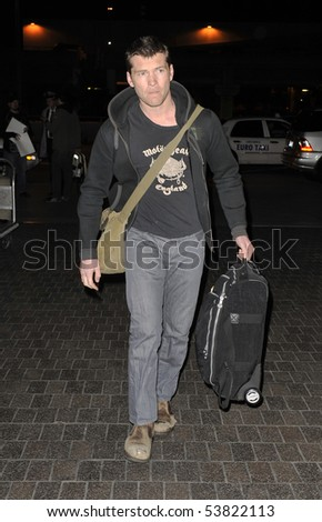 LOS ANGELES - MARCH 12 : Australian actor Sam Worthington star of Avatar and Terminator is seen at LAX airport with his bags after a international flight. March 12, 2010 in Los Angeles, california