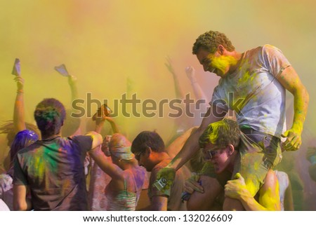 LOS ANGELES - MARCH 16 : Celebrants dancing during the color throw. Holi Festival of Colors on March 16, 2013 in Los Angeles, CA - stock photo