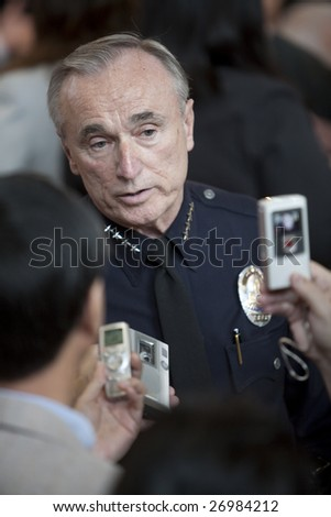 LOS ANGELES - MARCH 19: Chief William Bratton interviewed while waiting for President Barack Obama's town hall meeting to begin on March 19th, 2009 in Los Angeles. - stock photo