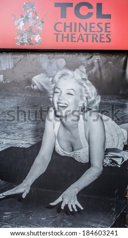 LOS ANGELES - MARCH 29: famous Marilyn Monroe poster outside the Chinese Theater on March 29, 2014 in Hollywood. TCL Chinese Theatre is a cinema on the Hollywood Walk of Fame in Los Angeles.  - stock photo