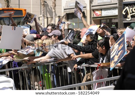 LOS ANGELES - March 17: Fans at the Kate Winslet's Hollywood Walk of Fame Star Receiving Ceremony at Hollywood Blvd on March 17, 2014 in Los Angeles, CA. - stock photo