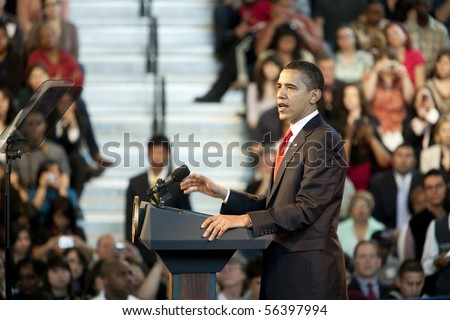 LOS ANGELES - MARCH 19: President Barack Obama speaking at a town hall meeting at the Miguel Contreras Learning Center on March 19, 2009 in Los Angeles. - stock photo
