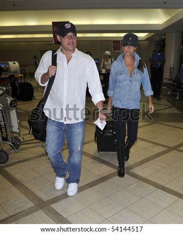 LOS ANGELES - MARCH 2 : Singer Nick Lachey ex husband of Jessica Simpson is seen with girlfriend Vanessa Manilo at LAX FMarch 2, 2010 in Los Angeles, California