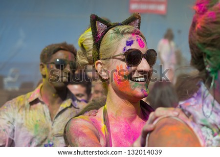 LOS ANGELES - MARCH 16 : Woman wearing bunny ears dancing to the music of the onstage band. Holi Festival of Colors on March 16, 2013 in Los Angeles, CA - stock photo