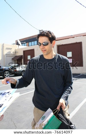 LOS ANGELES - MAY 4: Actor Ralph Macchio chatting and signing autographs for fans outside the Dancing with the Stars rehearsal studio May 4, 2011 Los Angeles, CA.