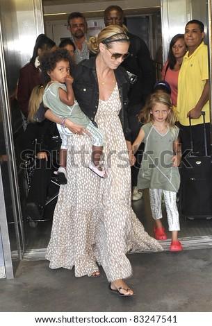 LOS ANGELES-MAY 12: Actress/model Heidi Klum with kids at LAX airport. May 12 in Los Angeles, California 2011 - stock photo