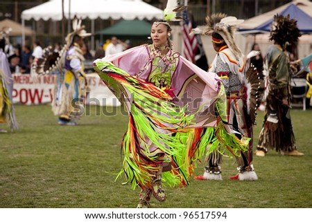 LOS ANGELES - MAY 2: American Indians dancing at the 24th Annual UCLA Pow Wow in Los Angeles on May 2nd, 2009. - stock photo