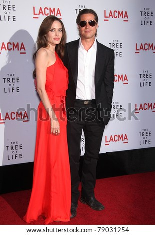 "LOS ANGELES - MAY 24:  Angelina Jolie & Brad Pitt arrive at ""The Tree of Life"" Los Angeles Premiere  on May 24, 2011 in Los Angeles, CA - stock photo"