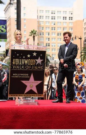 LOS ANGELES - MAY 23:  Carrie Underwood, Simon Fuller at the Simon Fuller Hollywood Walk Of Fame Star Ceremony at W Hotel - Hollywood on May 23, 2011 in Los Angeles, CA - stock photo